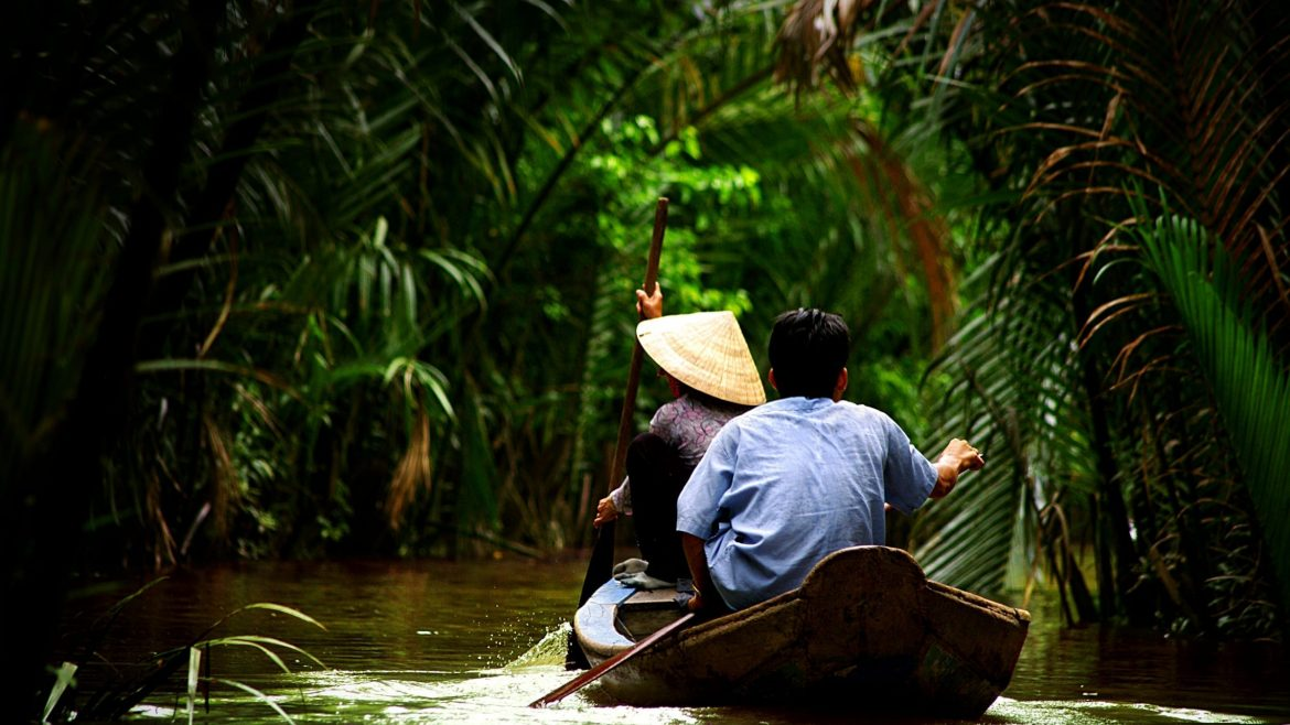 People paddling on Mekong River in Vietnam, included in tours offered by Asia Vacation Group