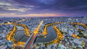 Aerial view of Saigon River at night in VIetnam,, included in tours offered by Asia Vacation Group